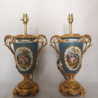 Pair Of 19th Century French Painted Porcelain And Ormolu Lamps