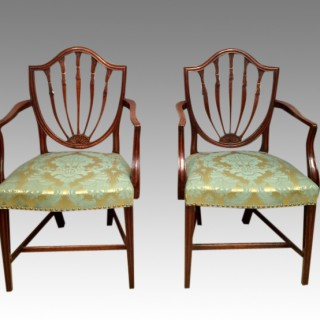 Pair of carved Hepplewhite mahogany elbow chairs.