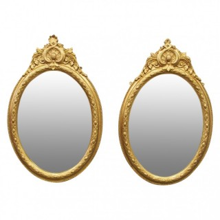 Pair of Victorian Giltwood Oval Wall Mirrors