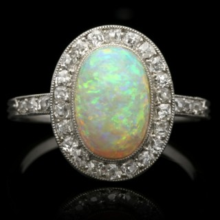 Edwardian opal and diamond coronet cluster ring, circa 1910.