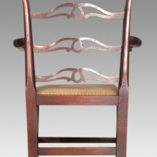 A set of seven Geo III mahogany dining chairs.