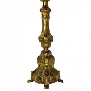 A BAROQUE GOLD PLATED CANDLESTICK