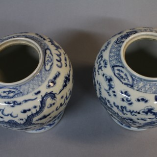 A pair of 19th century Chinese blue and white jars and covers