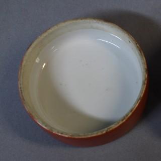 A pair of 19th century Chinese orange round ginger jars