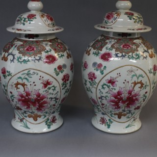 A pair of 19th century Chinese famille rose baluster jars and covers