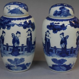 A pair of small 19th century Chinese blue and white ginger jars and covers
