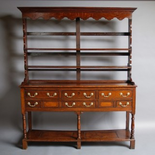 Early/Mid 19thc Welsh oak pot board dresser and rack of small proportions