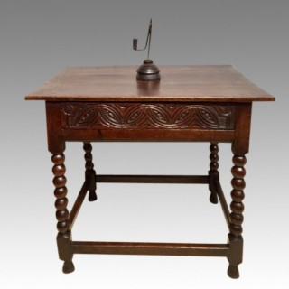 Charles II carved  oak side table.
