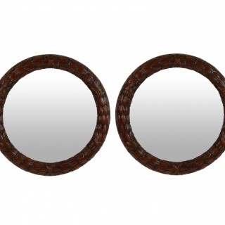 A PAIR OF MAHOGANY LAUREL WREATH MIRRORS
