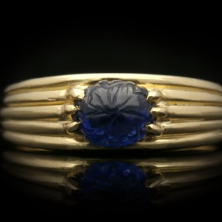 Cartier carved sapphire solitaire ring, circa 1950.