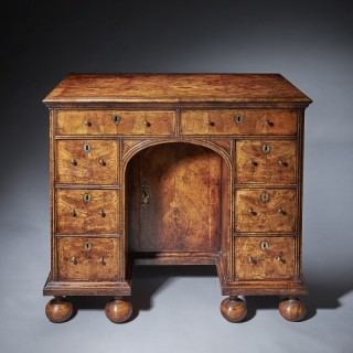 A  Queen Anne (1702-1714) burr and highly figured walnut kneehole desk