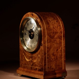 A Early French Original Electrical Bulle Burr Walnut Mantel Clock Inlaid with Guirlandes in Satin Wood.