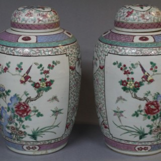 A pair of 19th century Chinese famille rose Jars and covers