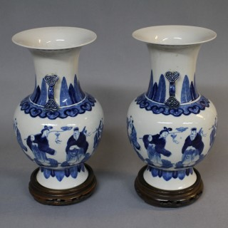 A pair of small 19th century Chinese blue and white vases