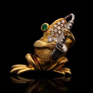 A delightful set of five gem-set musical frog brooches 1990 by Wolfe