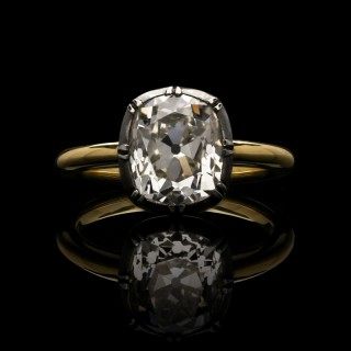A beautiful 3.05ct old mine brilliant cut diamond ring in antique style cut down collet setting.