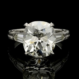 A 5.47ct old mine brilliant cut diamond ring with hand engraved platinum band.