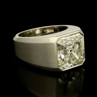 An 8.04ct old asscher cut diamond gypsy ring in satin finished platinum.