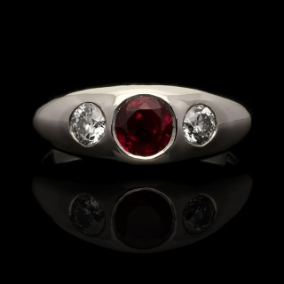 A platinum, ruby and old European cut diamond gypsy-set ring.