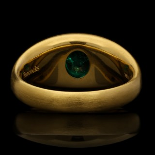 A 22ct yellow gold satin-finish gypsy-set band ring with a 1.58ct Colombian emerald.