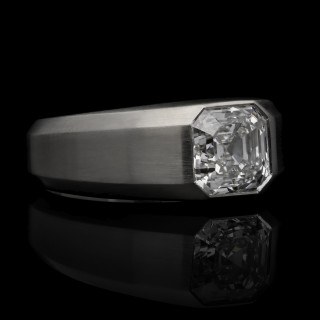 A 2.01ct diamond and brushed platinum geometric gypsy-set ring with bevelled edges.