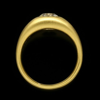 A 22ct satin-finish yellow gold gypsy-set band ring set with a 1.29ct old cut diamond.