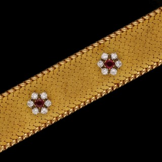 A beautiful 18ct yellow gold vintage bracelet with a central row of six ruby and diamond clusters  c.1965