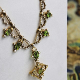 An exquisite Peridot & Seed Pearl Festoon Necklace with a matching Quatrefoil style detachable Pendant/Brooch in 15 Carat Yellow Gold, English, Circa 1900