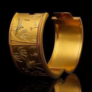 A rare Victorian three colour gold cuff bangle in the Japonisme stye with original fitted case.
