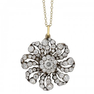Victorian diamond flower brooch/pendant with chain, English, circa 1890.