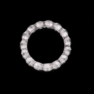 A  full diamond eternity ring set with 4.90cts of old European cut diamonds in platinum.