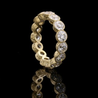 A  full diamond eternity ring set with 4.90cts of old European cut diamonds in yellow gold.
