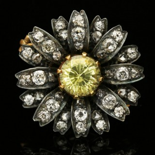 Victorian yellow sapphire and diamond flower brooch, circa 1880.