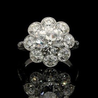An old European brilliant cut diamond cluster ring set in platinum with a total of 5.54cts.