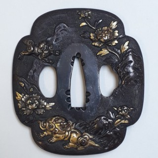 An antique Japanese iron tsuba with multimetal fo dog design