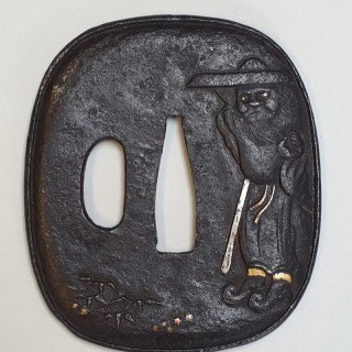 An antique Japanese iron tsuba with multimetal decoration of shoki