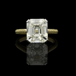 A beautiful 5.46ct vintage emerald-cut diamond solitaire ring with hand engraved yellow gold mount.