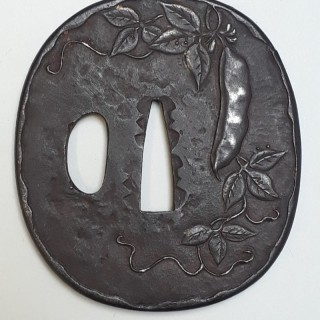 An antique Japanese iron tsuba with peapod design