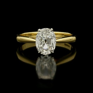 A classic 1.20ct old-cut oval diamond solitaire ring set in platinum and 18ct yellow gold.