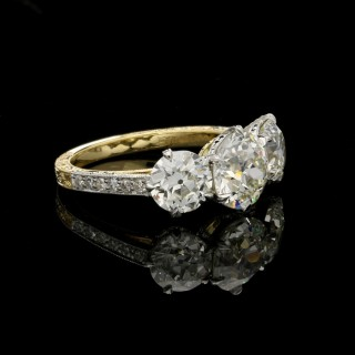 Three stone old European cut diamond ring with 3.64ct total weight in gold and platinum.