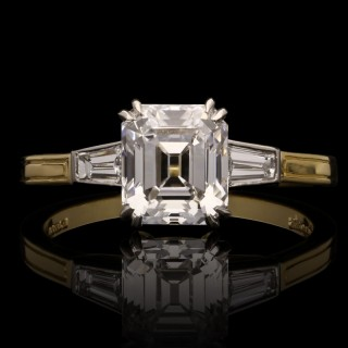 A 1.66ct D IF emerald-cut diamond ring with tapered baguette shoulders.