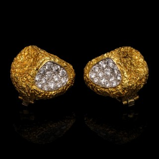 A pair of abstract ear clips in heavily textured 18ct yellow gold set with round brilliant diamonds.