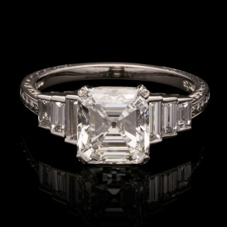 A beautiful 2.45ct Asscher cut diamond ring set in platinum with baguette diamond side stones.