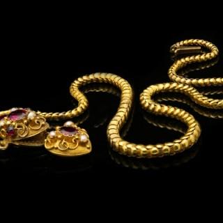 Antique garnet and pearl set snake necklace, circa 1880.
