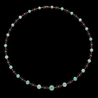 A beautiful Victorian white opal cabochon necklace with diamond set scroll links between. c.1900