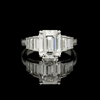 A stunning 3.19ct D IF emerald cut diamond ring with baguette diamond shoulders set in platinum.
