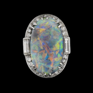 Black opal and diamond cluster ring, circa 1925.