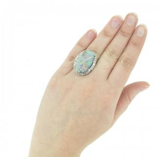 Black opal and diamond cluster ring, circa 1925.