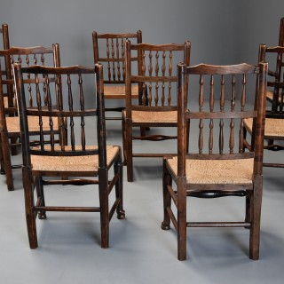 Matched set of eight mid 19th century ash spindle back chairs of superb patina