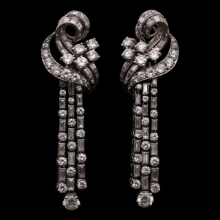 A stylish Retro pair of diamond and platinum scroll and tassel earrings with detachable drops.